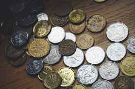 close up of coins on table